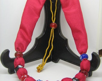 Fabric and lamp work bead necklace