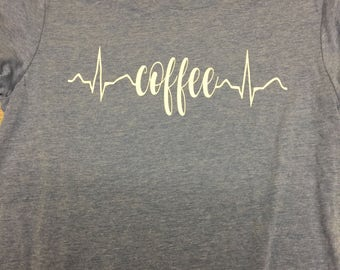 Tri blend short sleeve tee shirt with a coffee/rhythm strip decal