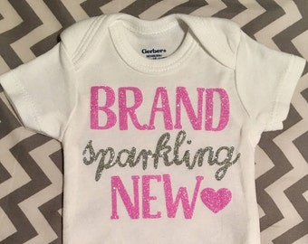 Brand Sparkling New onesie NEWBORN