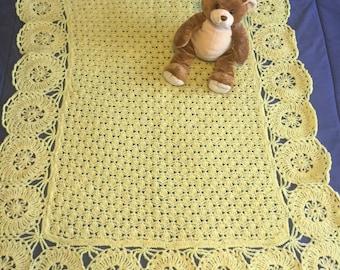 Crochet baby blanket in yellow