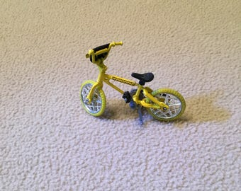 Yellow bmx style bicycle for dollhouse size