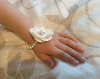 Pretty childs pearl bracelet with handmade flower.  Flowergirl jewellery.  Bridesmaid corsage bracelet.