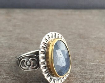 Freeform rose cut natural blue sapphire ring with a 22k gold bezel, sterling silver band and accents, sterling silver ring