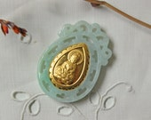 vintage green jade pendant with gilded figure of Quanyin