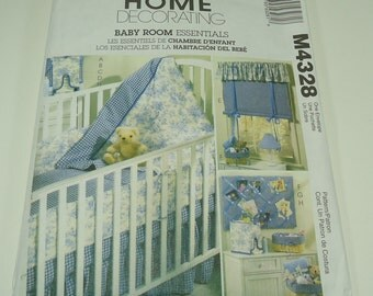 McCall's Home Decorating Baby room Essentials Pattern M4328 Crib Quilt, Crib Bumpers, Matress Cover, Crib Skirt, Diaper Dispenser