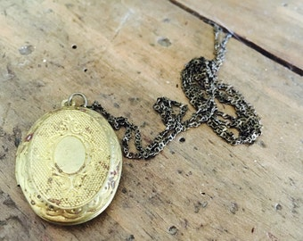 An authentic aged vintage oval locket necklace, brass soldered chain, put your secret message inside