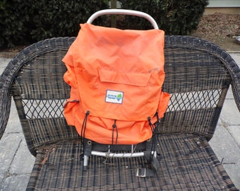 "Wenzel vintage external frame backpack, orange, measures 30"" long 15"" wide no rips or tears in the backpack frame fabric"