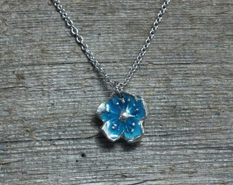 Blue glow in the dark flower blossom necklace