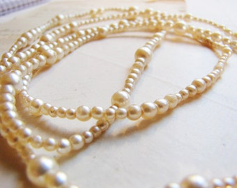 long faux pearl necklace - graduated strand of glass pearls in ivory cream - 48 inches - vintage costume jewelry