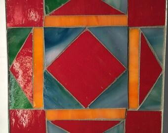 Red, Blue, Orange and Green Triangular Geometric Table Mosaic Trivet