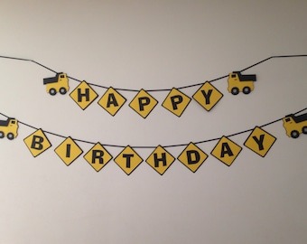 Happy Birthday banner of construction signs with dump trucks for construction theme birthday party