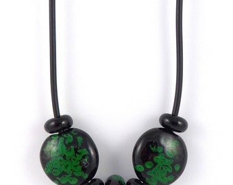 black and mozaic green lampwork glass bead pendant on rubber cord