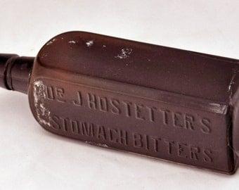 "Antique Ca 1890 Embossed Dr J HOSTETTERs STOMACH BITTERS Mold Amber Bottle 8 3/4""h x 2 9/16""sq 18 Fluid Oz Part Original Bck Label V G Cond"