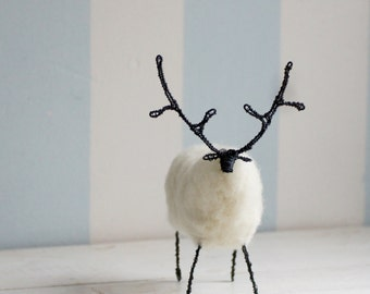 Wired deer with white wool