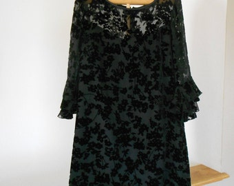 Vintage ladies black flocked dress.  Size medium.