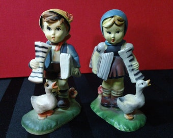 Set of two vintage plastic Hummel style Children Figurines ~ Boy & Girl with Ducks holding Newspapers