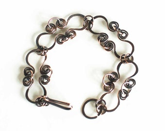 "Copper Bracelet Hoops with Celtic Spirals Antiqued Copper 8 Link 7.5"" Bracelet"