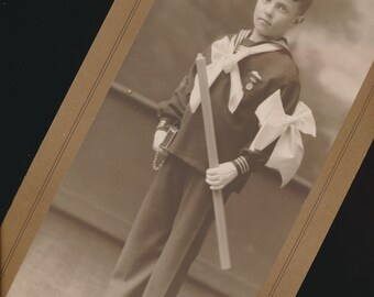 vintage mounted photo of a boy in middy uniform with bow and Bible