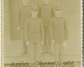 Soldiers in uniforms antique cabinet photo