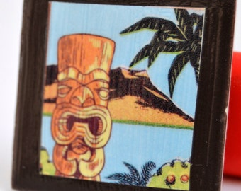 Tile magnet with Tiki statue on black background