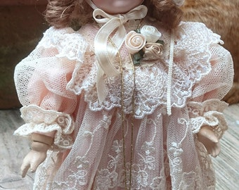 Beautiful Mundia China and composition body doll