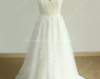 Romantic ivory a line tulle lace wedding dress with illusion neckline and pale blush lining