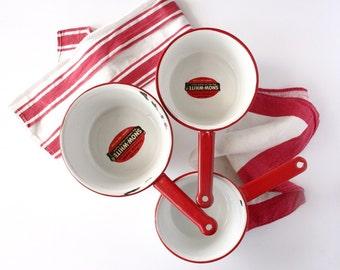 Vintage red and white enamel pans, set of three Snow-White sauce pans