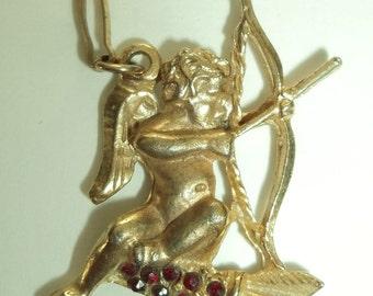 Vintage Gold tone  Cupid Cherub with Garnet rhinestones Pendant