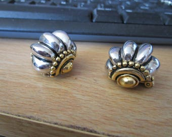 "vintage silver/goldtone large heavy clip on earrings in new condition 1""across back"