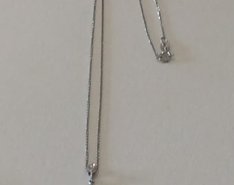 An 18ct Gold And Diamond Pendant and Chain