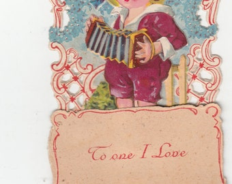 "Antique Pull Down Boy Playing Concertina ""To One I Love"" Some Embossing-Openwork-5.5"" X 3"""