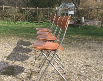 Four mid-century Danish teak folding chairs with metal frame. Made in Denmark.