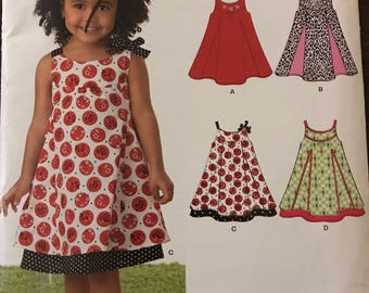 New Look 6974 - Little Girls Summer A Line Dress with Contrast Pleats and Trim Options - Size 1/2 1 2 3 4