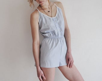 Pastel jumpsuit with buttons for sleep