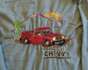Vintage 70s hand embroidered cotton chambray big mac shirt Chevy Chevrolet pickup truck cactus sun 44in L hippie