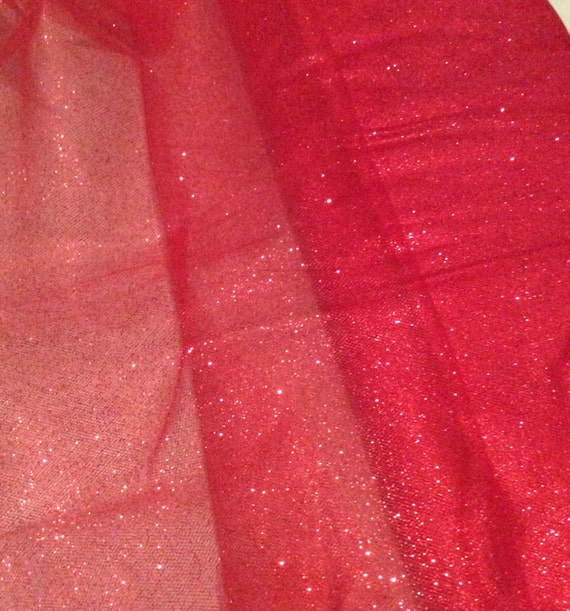 Glitter tulle fabric bolt at low wholesale prices. Perfect for weddings, special occasions & more. Wide range of colors available.
