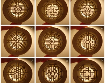 Chinese Windows rolls - Chinese windows cut out paper sculptures inside of cardbord rolls