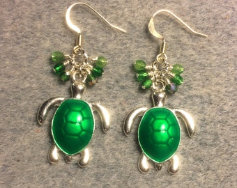 Bright green enamel turtle charm dangle earrings adorned with tiny dangling green Czech glass beads.
