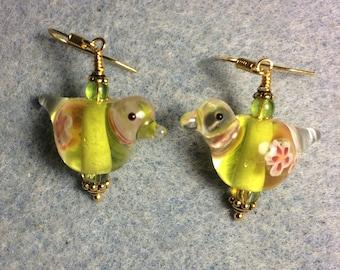 Translucent yellow green lampwork songbird bead earrings adorned with yellow green Czech glass beads.