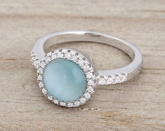 Cat's Eye Ring | Blue | Small, delicate stones accent a round, solitary blue cat's eye stone in this femininely classic ring