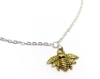 Gold tone bumblebee charm bracelet