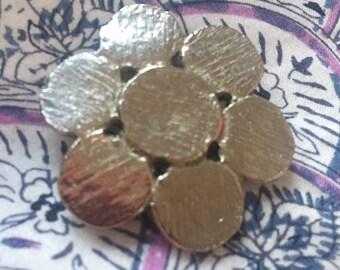 Silver metal flower brooch