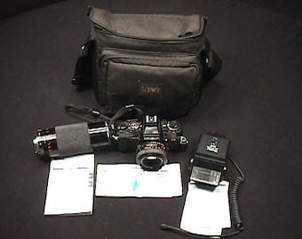 Vintage Minolta Model X - 700 35 mm Camera Nikon Zoom Lens & a Vivitar Auto Thyristor Flash all in a Case Ready to Use