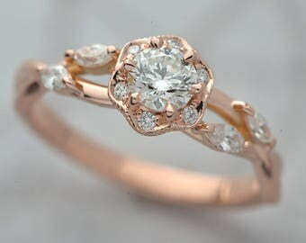 Diamond Engagement ring .30ct to .50ct  Pink, white, yellow gold  with a round center GIA and octagon halo 4 marquesses  on the side