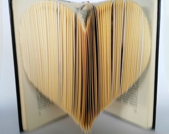 Heart Book Folding, the heart in a book, pages that pulsate with life,