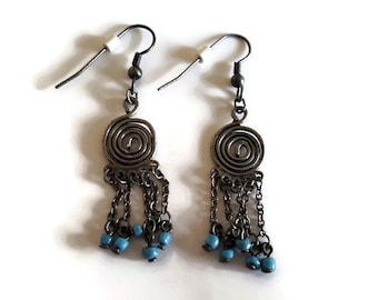 Spiral design dangle earrings with dangling chains and blue beads