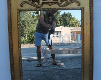 French Antique Gilt Wall Mirror .