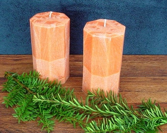 Pair of orange octagon pillar candles