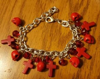 Red skull and cross charm bracelet
