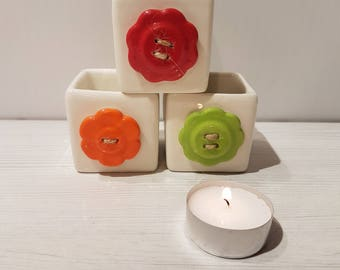 Set of three ceramic candle holders with buttons